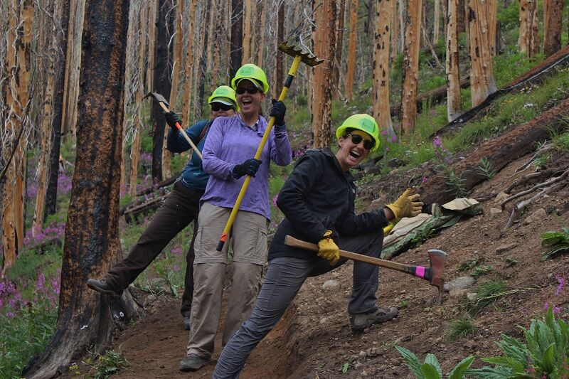 Volunteers working on the trail